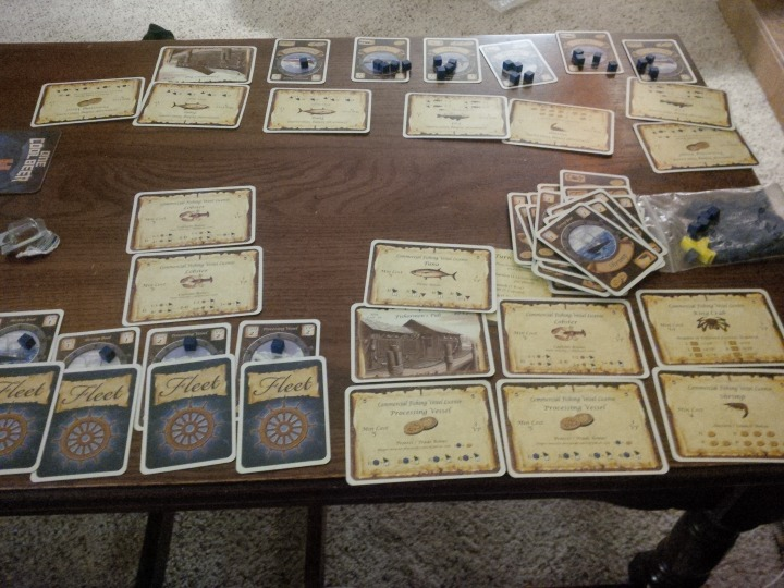 A two-player game of Fleet set up on a coffee table.